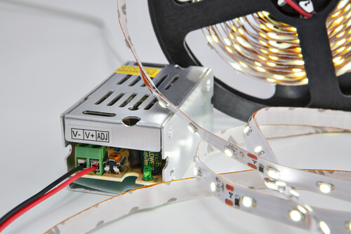 Lighted diodes on reel LED tape, and voltage converter